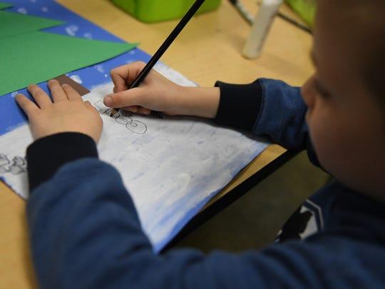 A kindergartener works on a drawing. Des Moines Register file photo.