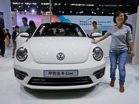 Visitors tour the Volkswagen booth during Guangzhou 2013 Auto Show in China's southern city of Guangzhou