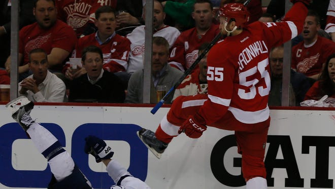 Red Wings defenseman Niklas Kronwall levels the Lightning's Nikita Kucherov with a check late in the second period of the Wings' 5-2 loss in Game 6 Monday at Joe Louis Arena.