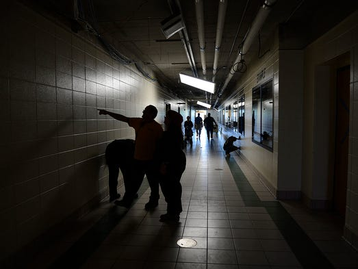 Crews work on cleaning up the damage at Green Bay Preble High School on Thursday, Aug. 14, 2014. Fire crews were called to the school early Friday to extinguish a fire in the bleachers in the gymnasium. Smoke damage was present throughout the building. Evan Siegle/Press-Gazette Media