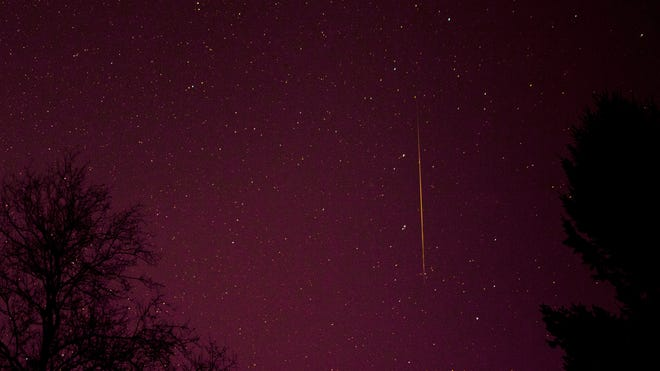A falling star from the Geminid meteor shower photographed in Churchville, Md., on Dec. 12, 2012.