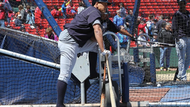 Alex Rodriguez watches batting practice before a game with Boston Red Sox at Fenway Park on May 2. Rodriguez's chase for his 3,000th career hit resumes tonight.