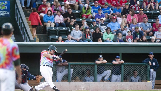 Vermont Lake Monsters batter Nick Collins connects with a pitch during the fourth inning of Friday night's game against the Brooklyn Cyclones at Centennial Field.