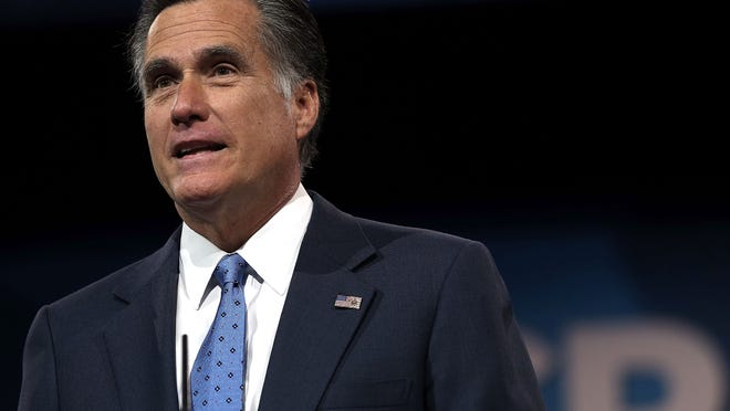 """Former Republican presidential candidate Mitt Romney speaks at the BYU Marriott Center in Provo, Utah, Tuesday, Nov. 18, 2014.  His forum was titled """"Life Lessons From the Front.""""  BYU invites experts in their fields, noted public officials  to come to campus to deliver a Forum address on campus. (AP Photo/The Salt Lake Tribune, Al Hartmann) ORG XMIT: UTSAC111"""