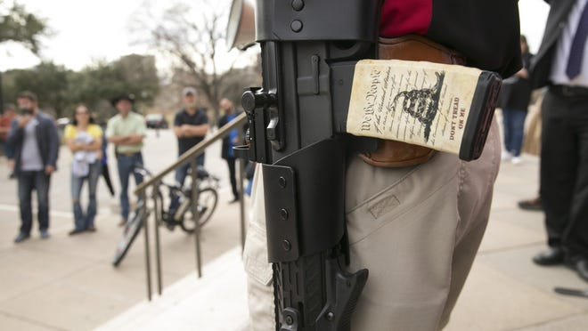 CJ Grisham, president and founder of Open Carry Texas, carries a pistol at the Open Carry Texas rally at the Capitol in 2017. [AMERICAN-STATESMAN/FILE]