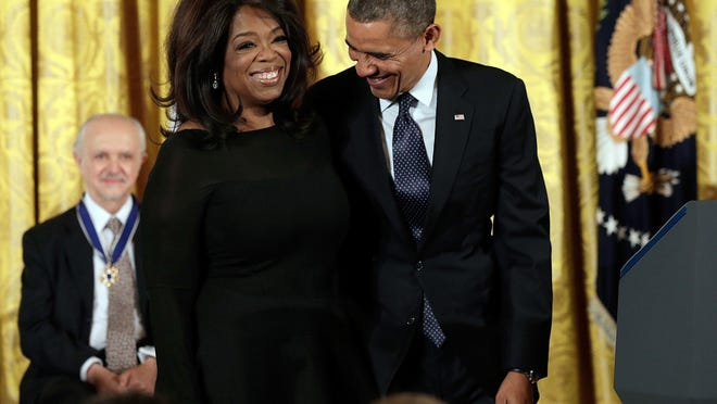 President Barack Obama awards the Presidential Medal of Freedom to Oprah Winfrey on Nov. 20, 2013, in the East Room at the White House. In his new memoir, Obama says Winfrey was a celebrity who left most of his staff starstruck.