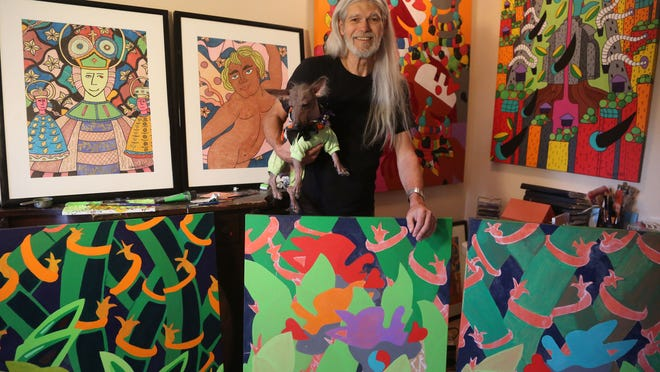 Palm Springs artist Juan-Manuel Alonso and his dog, Nynja, pose for a portrait in his home studio.