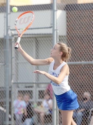Boonville No. 3 singles player Arjiana Webster serves the ball against Knob Noster's Allison Croft Tuesday night at the high school tennis courts. Webster defeated Croft 8-4. The Lady Pirates tennis team also defeated the Panthers 9-0 to improve to 2-2 on the season.