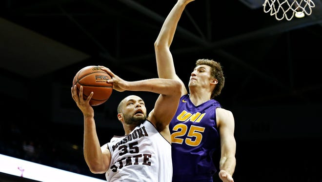 Missouri State Bears forward Camyn Boone (35) shoots as Northern Iowa Panthers forward Bennett Koch (25) attempts to defend him during first half action of the Missouri State Bears game against the Northern Iowa Panthers at JQH Arena in Springfield, Mo. on Jan. 6, 2015.