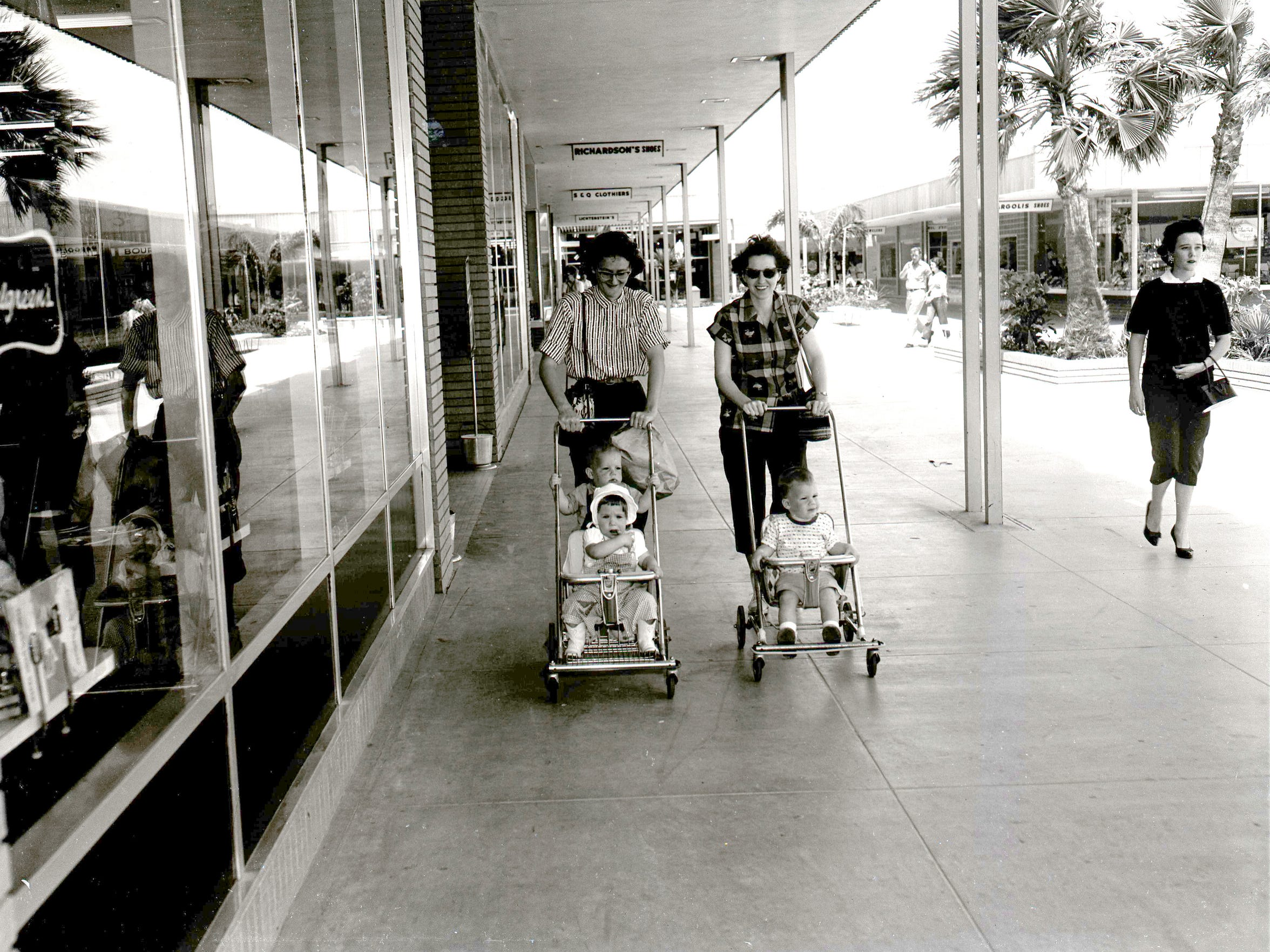 Parkdale Plaza was nearing its one-year anniversary in April 1958 as these shoppers walked the concourse in front of Walgreen's. Other tenants were Richardson's Shoes, S&Q Clothiers and Lichtenstein's department store.