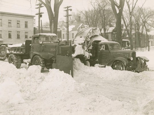The rotary plow loading snow from South Winooski Ave. in Burlington into a truck headed for the dumping area at the foot of College St. Each load contained approximately 10 cubic yards.