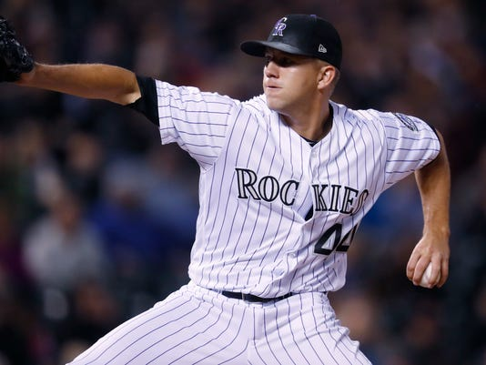 Colorado Rockies starting pitcher Tyler Anderson delivers a pitch to Miami Marlins' Miguel Rojas in the sixth inning of a baseball game Tuesday, Sept. 27, 2017, in Denver. The Rockies won 6-0. (AP Photo/David Zalubowski)