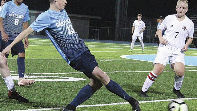 In less than five matches this past spring, Jonah Collins, No. 13, earned a starting spot for new Bartlesville High School head boys soccer coach Anthony Tucker. Next up, Collins is set to follow in his parents' footsteps to attend Oklahoma Wesleyan University, with which he has signed a letter of intent to play men's soccer. His mom Tracie Gillette is the OKWU head volleyball coach. Mike Tupa/Examiner-Enterprise