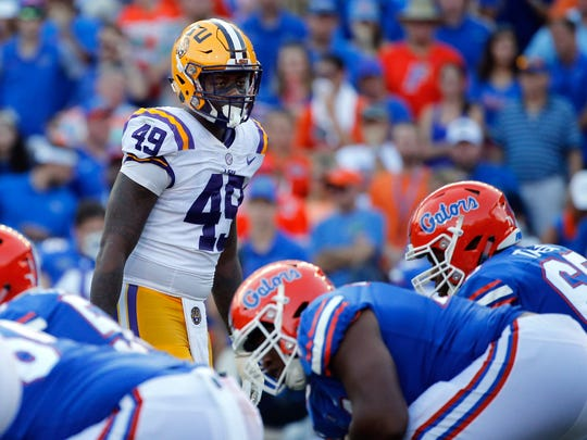 Oct 7, 2017; Gainesville, FL, USA; LSU Tigers linebacker Arden Key (49) looks on against the Florida Gators during the second half at Ben Hill Griffin Stadium.