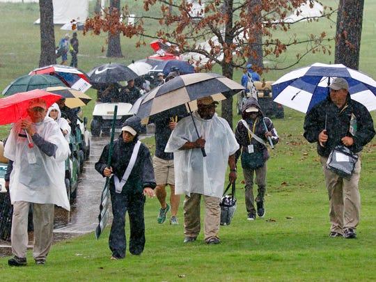 Standard bearers, caddies, officials, fans and golfers