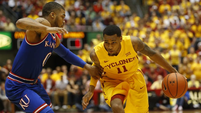 Iowa State guard Monte Morris (11) drives the ball past Kansas guard Frank Mason III (0) Monday at Hilton Coliseum in Ames.