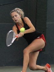 Madi Mueller competes during the girls 18 singles final