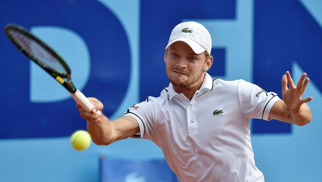 David Goffin of Belgium returns the ball to Horacio Zeballos of Argentina during their second-round match at the Swiss Open.