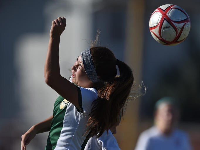Action photo from the Bishop Manogue at Wooster varsity