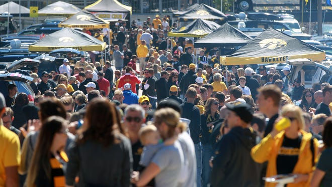 Iowa and Iowa State fans tailgate outside at Kinnick Stadium on Saturday, Sept. 13, 2014.