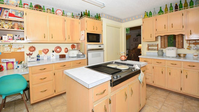 3641 Sweet Bay Drive, the kitchen features a center island and writing desk.