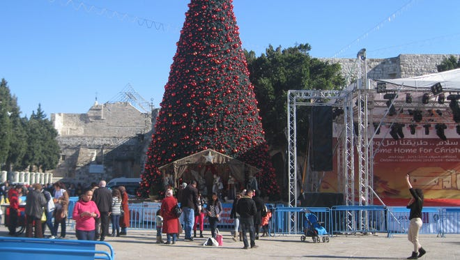 Tens of thousands of pilgrims descended on Bethlehem in the days leading up to Christmas. Despite ongoing repairs to the Church of the Nativity, pilgrims have been able to access the church, built atop the traditional site of Jesus's birth.   In Manger Square (pictured here), adjoining the church, the Palestinian Authority erected a large Christmas tree, nativity scene and Christmas decorations.