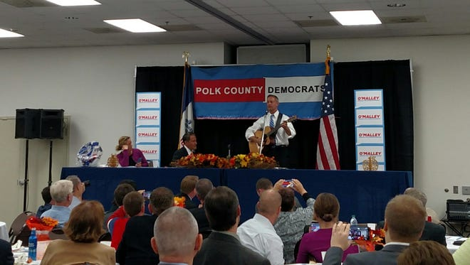 Democratic presidential candidate Martin O'Malley plays guitar after speaking at the Polk County Democrats' Fall Dinner Oct. 9, 2015.