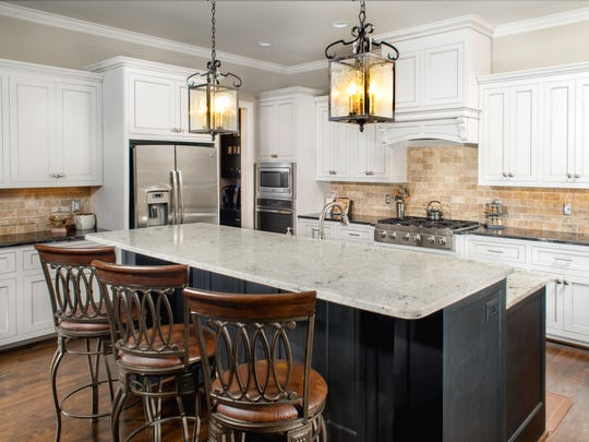 Galloway Custom Homes builds a custom kitchen, complete with custom cabinetry and a sizeable island that also functions as a preparation area.  It is perfect for casual dining as well as entertaining.
