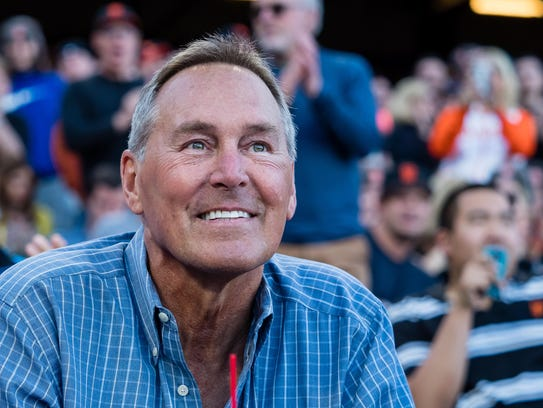 Former NFL player Dwight Clark is introduced to a standing