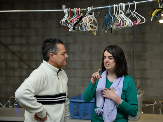 Dave Krikac talks with daughter Sara at Our Thrift