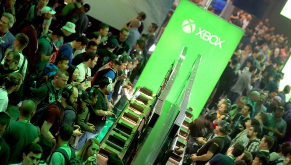 Attendees visit the Xbox booth during the Electronic