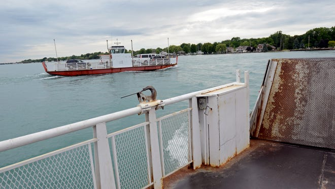 A ferry heads to the mainland Monday, June 13, from Harsens Island on the St. Clair River.