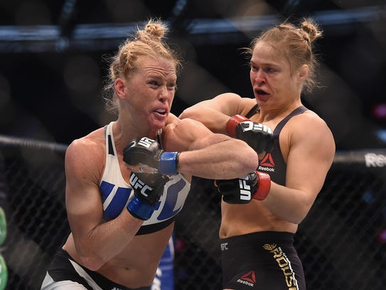 Holly Holm (left) upset Ronda Rousey with a headkick