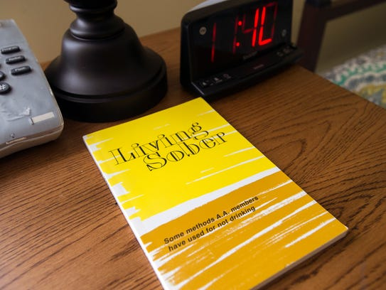 A book on sober living sits on a table in the living