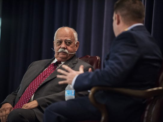 Col. Gaillard Peck (left) is interviewed during the