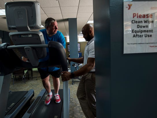 Ken Mullinax walks on a treadmill under the instruction