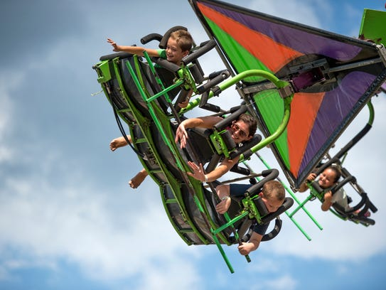 Fair-goers ride the Cliff Hanger at the Broome County
