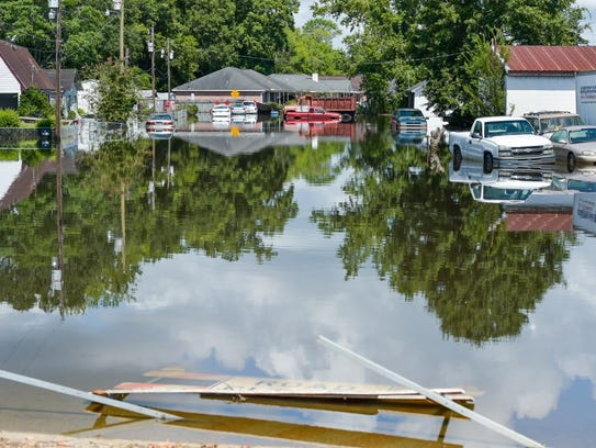 Flood waters remain high along Carmel Dr. August 22,