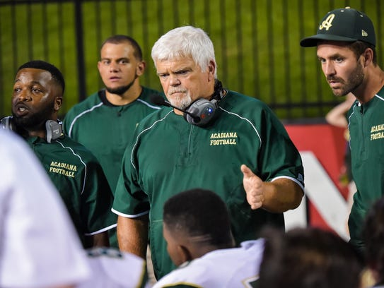 Acadiana High coach Ted Davidson (center) has had players
