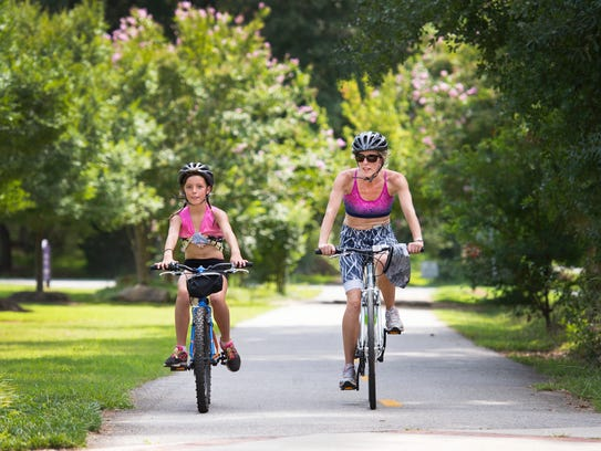 Jo Williams and her daughter Zoe, 9, bike down the