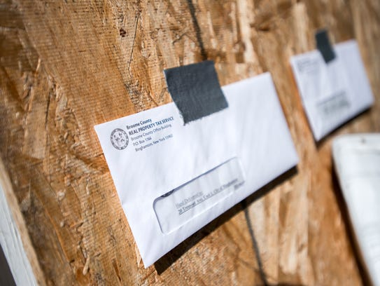 Property tax notices posted outside 20 Tremont St.