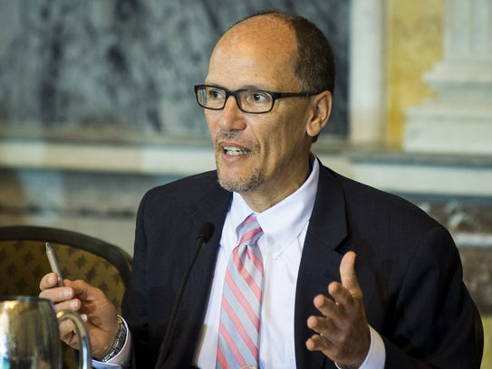 Tom Perez delivers remarks during a public meeting