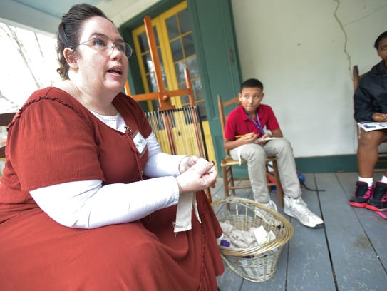 Katie Ohare works with Middle school students on a
