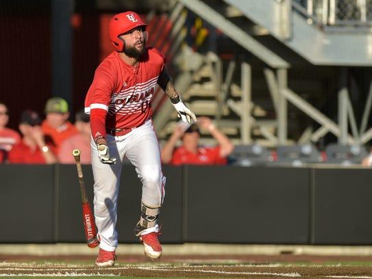 Ragin' Cajuns first baseman Alex Pinero  works at the