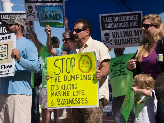 Area residents protest Lake Okeechobee discharges and the effect on their businesses and community in this Feb. 26, 2016 file photo.