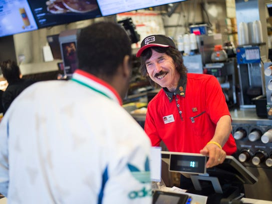 Johnson City McDonalds employee Syd Bouton helps a
