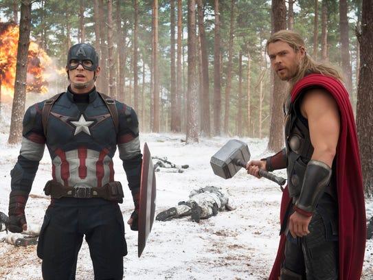 Chris Evans, left, and his Marvel co-star Chris Hemsworth
