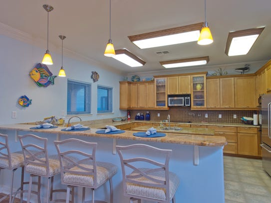 A spacious kitchen with double refrigerators, extendable