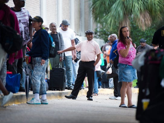 Catham County residents wait to board evacuation busses