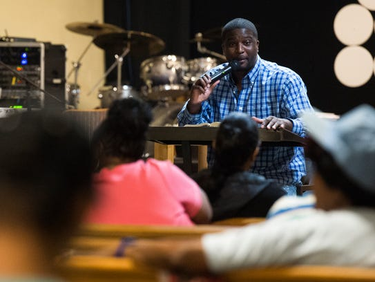 Pastor Darian Blue leads bible study at Nicholtown